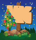 Signboard and Christmas tree Royalty Free Stock Image