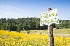 Signboard in the countryside with written. Natural Product on it - image with copy space Royalty Free Stock Images