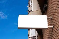 signboard Derisione rettangolare di forma su sulla parete fotografie stock