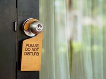 Signboard do not disturb hanging on open door in a hotel royalty free stock images