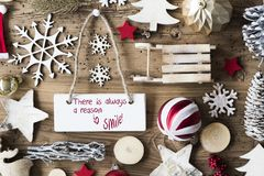 Rustic Christmas Flat Lay, Quote Always Reason To Smile. Signboard With English Quote There Is Always A Reason To Smile. Christmas Decoration Like Sled, Ball royalty free stock image