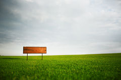 Signboard in the field Stock Photography