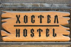 Signboard hostel. inscription in two languages. Royalty Free Stock Photos