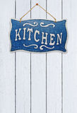 Signboard kitchen on a wooden background Royalty Free Stock Photos