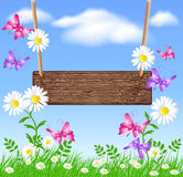 Signboard on the meadow with daisies Royalty Free Stock Images