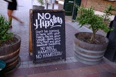 The humor sign board with the hipster theme on it royalty free stock photo