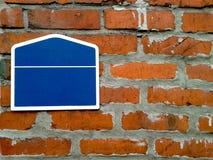 Signboard on old brick wall Stock Photos