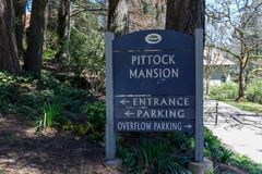 Signboard of The Pittock Mansion, famous landmark and tourist attraction of the city of Portland. Portland, Oregon, USA - April 19, 2018: Signboard of The Stock Photos