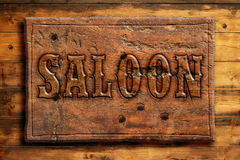 Signboard of saloon. On a wooden wall Royalty Free Stock Photos