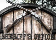 Signboard `Sheriff`s Office` with two old crossed lever rifles. royalty free stock photos