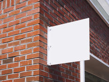Signboard shop Mock up White metal sign display on brick wall. Building exterior Stock Image