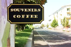 Signboard `Souvenirs Coffee`. Black and white photo.  royalty free stock photography