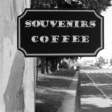 Signboard `Souvenirs Coffee`. Black and white photo royalty free stock photography