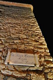 """The signboard on a stone tower with the inscription in french """"La tour carrée - musée des traditions locales"""" Royalty Free Stock Photography"""