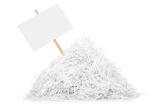 Signboard stuck in a pile of shredded paper Royalty Free Stock Photos