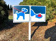 Signboard with symbol of clean up after your dog poop. Signboard with symbol of clean up after your dog poop, warning sign royalty free stock photography