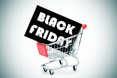 Signboard with the text black friday in a shopping cart, vignett Stock Photography