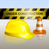 Signboard with traffic cone and helmet Royalty Free Stock Photography