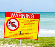 The signboard warning no swimming. Royalty Free Stock Photo