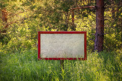 Signboard in the woods Royalty Free Stock Photography