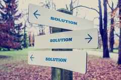 Signboard with the word Solution with arrows pointing in three d Royalty Free Stock Images