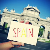 Signboard with word Spain and the Puerta de Alcala in Madrid in Royalty Free Stock Images
