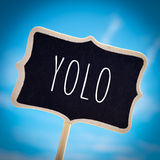 Signboard with the word yolo, vignetted Royalty Free Stock Photos