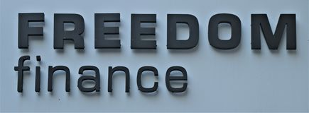 Signboard with the written `` Freedom Finance `` stock photo