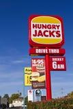 Signe affamé de bord de la route de plots d'aliments de préparation rapide Image libre de droits