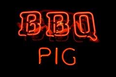 Signe au néon de porc de BBQ Photo libre de droits