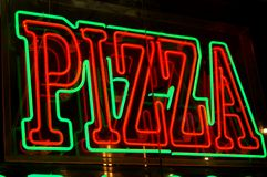 Signe au néon de pizza Photo stock