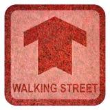 Signe au sol de marche de rue Photo stock