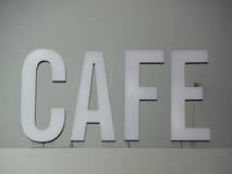 Signe blanc monté supérieur de café avec des fils Photo libre de droits