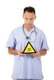 Signe caucasien de danger de docteur d'homme Photos libres de droits