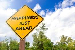 Signe conceptuel de bonheur juste en avant image stock