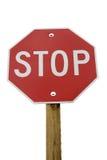 Signe d'arrêt - poteau en bois Image stock