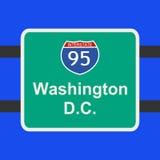 signe d'autoroute de C.C vers Washington Images libres de droits