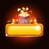 Signe d'or de bannière de salle de cinéma avec du maïs de bruit et l'espace de copie Photographie stock