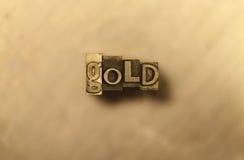 Or - signe d'impression typographique en métal Photographie stock