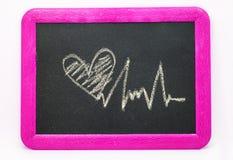 Signe de battement de coeur, coeur d'amour sur un tableau Image libre de droits