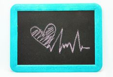 Signe de battement de coeur, coeur d'amour sur un tableau Image stock