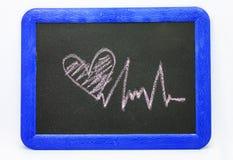 Signe de battement de coeur, coeur d'amour sur un tableau Photographie stock libre de droits