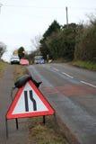 Signe de courses sur route Image libre de droits