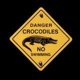 Signe de crocodiles de danger photographie stock