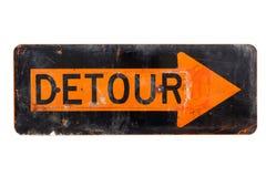 Signe de détour - vieux signe de route orange et noir Photos stock
