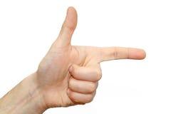Signe de doigt de direction d'exposition de pouce de plan rapproché Image libre de droits