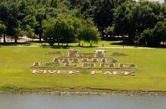 Signe de fleur de parc de rivière d'île de boue à l'île de boue Photos libres de droits
