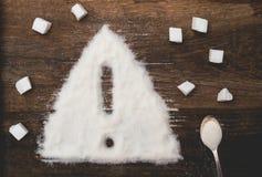 Signe de l'attention fait de sucre granulé image stock