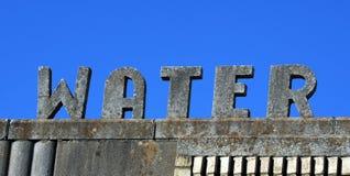 Signe de l'eau de ciment photographie stock libre de droits