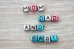 Signe de papa et de bébé de maman Photographie stock
